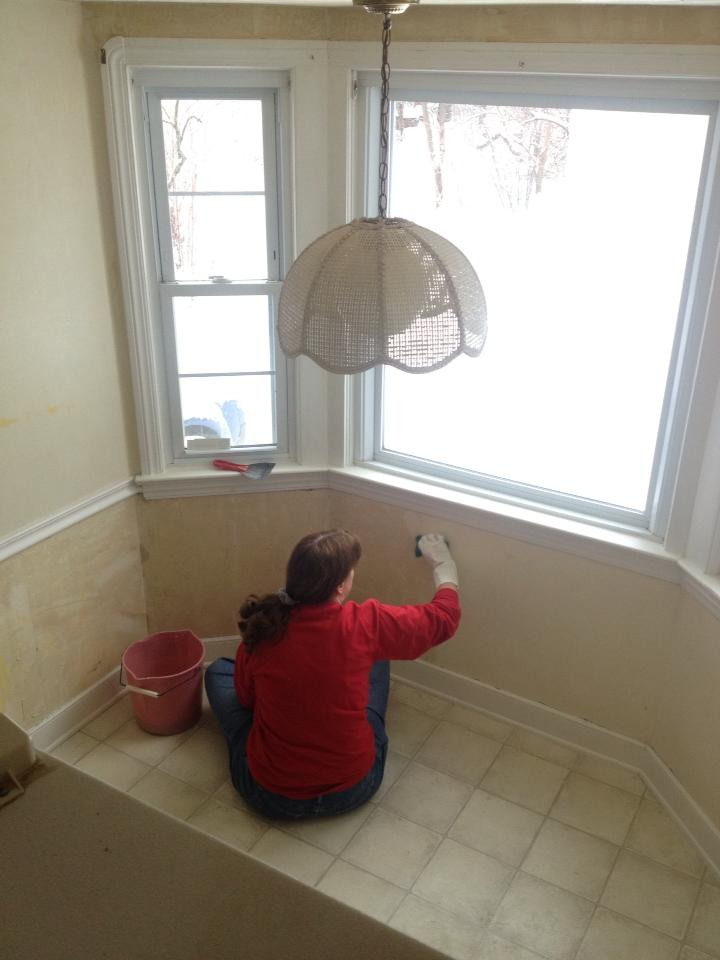 My hard-working MIL cleaning glue off of the lower level of the wall.